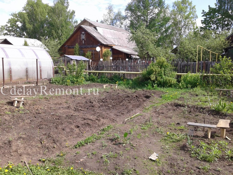 Снятие плодородного слоя почвы и разметка фундамента