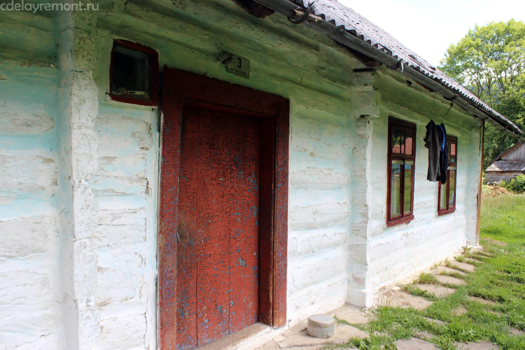 Оштукатуренные стены дома из бруса